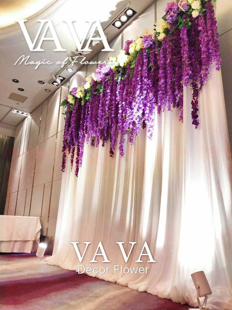 Purple flower garland for the ceremony backdrop